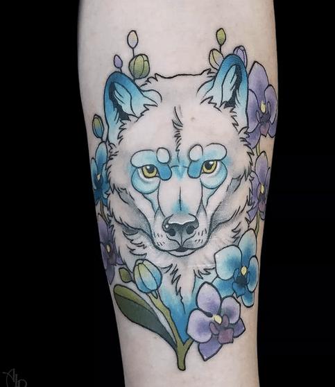 Beautiful blue and white wolf head tattoo by @theartofamberramirez