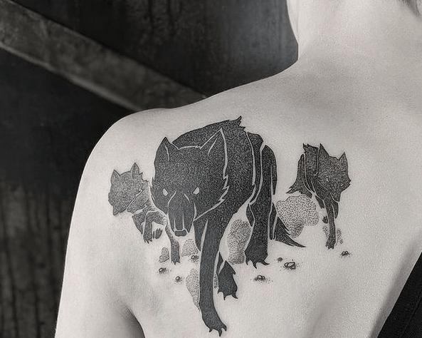 Black wolf pack tattoo by @maschinenraum.tattoo
