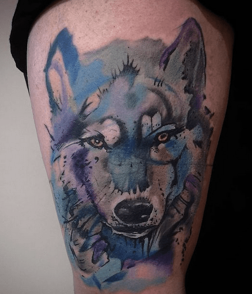 Blue watercolor wolf head tattoo by @ozgur.kucukbasa