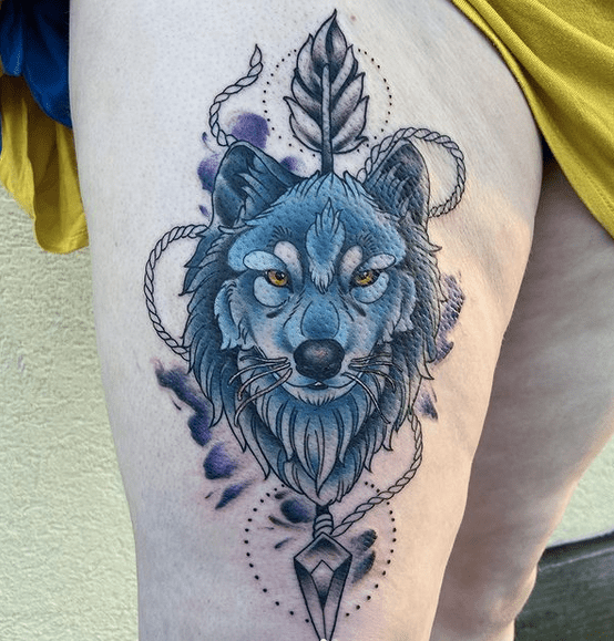 Blue wolf head with arrow tattoo by @inkdica
