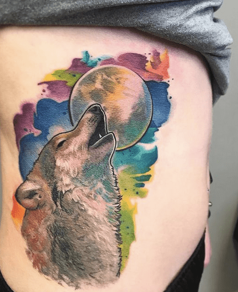 Bright color watercolor howling wolf tattoo by @redhousetattoobuffalo