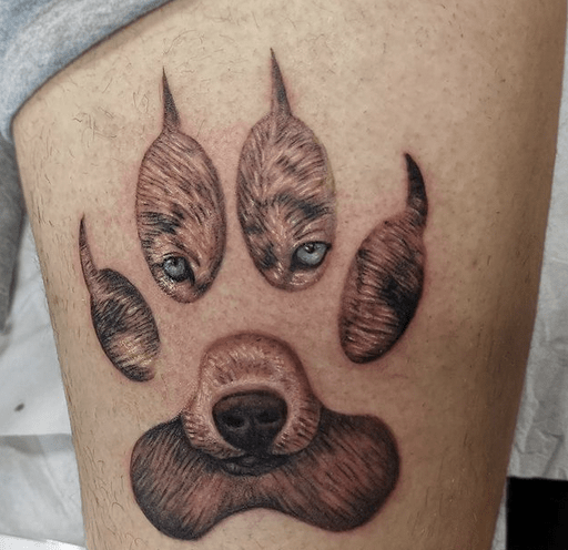Brown wolf paw tattoo by @twininkleigh