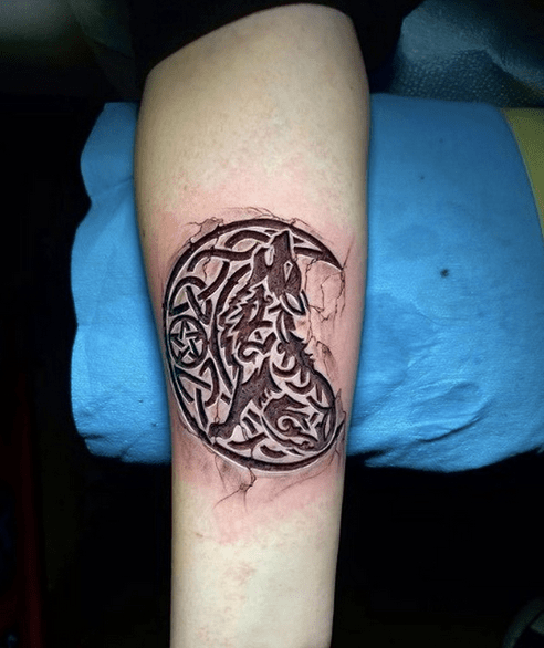 Celtic wolf howling at the moon tattoo by @tattoo_elvis