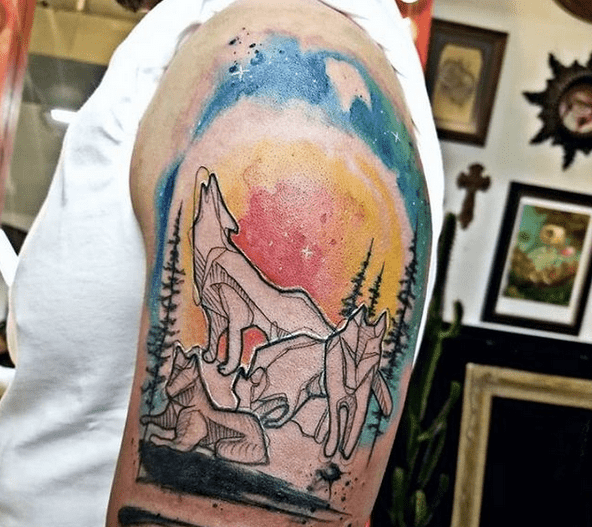 Colorful sky watercolor wolf tattoo by @equinoxtattoo