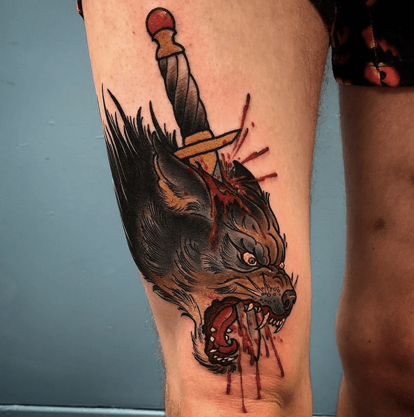 Dagger wolf head tattoo by @the.storm.cloud