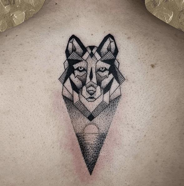 Dotwork geometric wolf tattoo by @anagarcia.t
