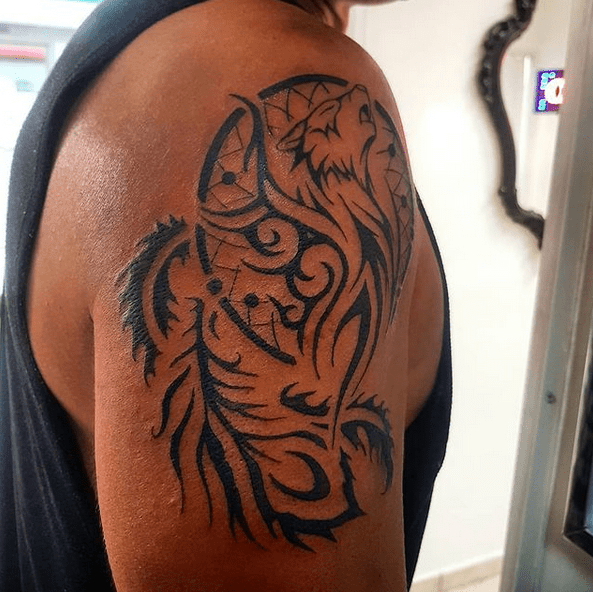 Dreamcatcher tribal wolf tattoo by @ofelia_tattoo_studio
