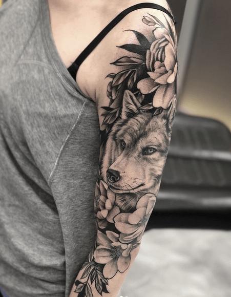 Feminine flower wolf tattoo sleeve by @meagma