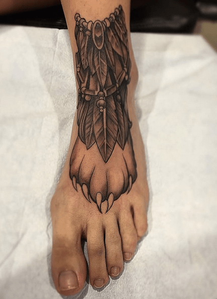 Foot wolf paw tattoo with feathers by @lowman3zero