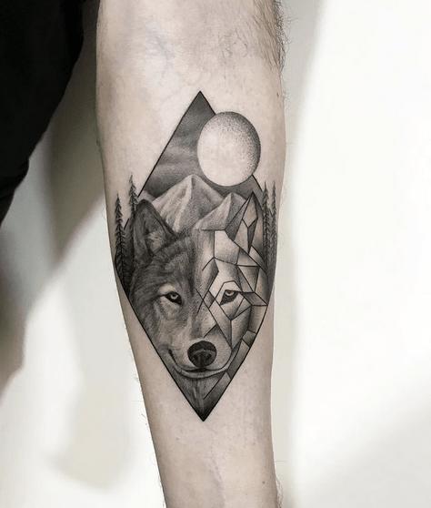 Framed geometric wolf moon tattoo by @lapinuptattoo