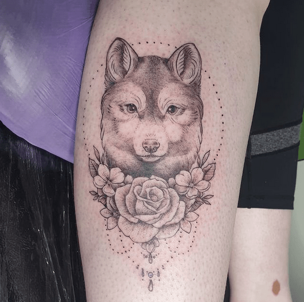 Gentle small wolf tattoo by @budart10