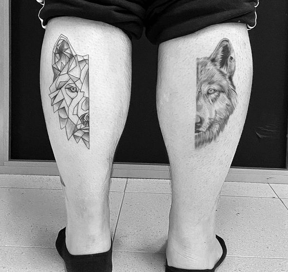 Geometric and realistic wolves on calves tattoos by @woolloomoolootattoostudio