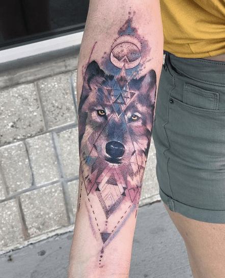 Geometric watercolor wolf tattoo by @mullytattoo