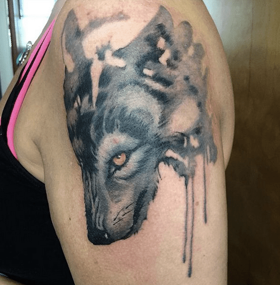 Grey watercolor wolf tattoo by @mike.guidone
