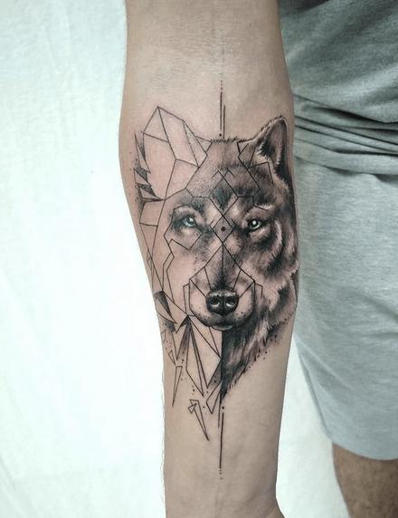 Half realistic half geometric wolf tattoo by @robinkhoodtattoo