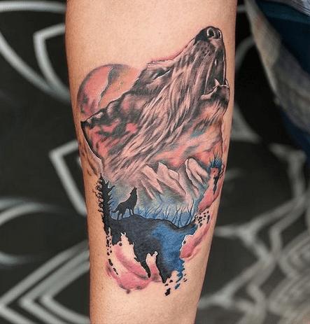 Howling watercolor wolf tattoo by @1920tattoozhub