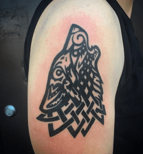 Intricate Celtic tribal wolf by @christinapelltattoos