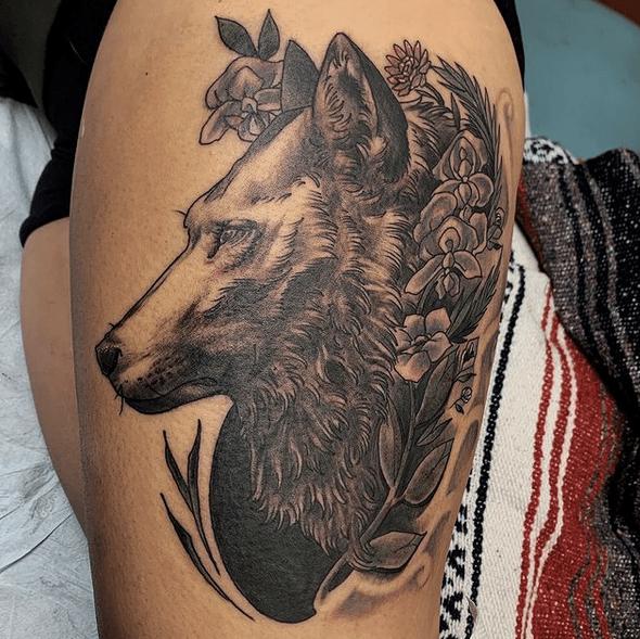 Lovely flowers wolf head tattoo by @jamiebartletttattoos