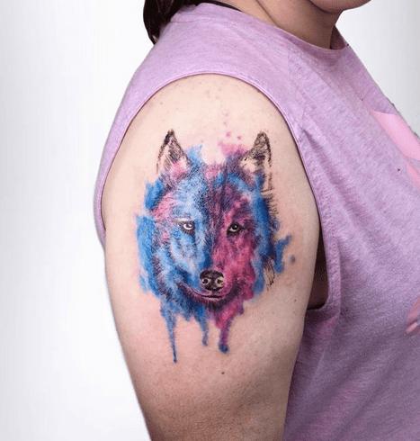 Pink blue watercolor wolf tattoo by @cameronhobbs_art