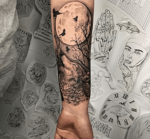 Realistic wolf full moon tattoo by @sarius_ink