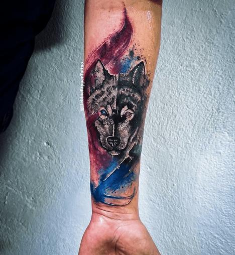 Red blue watercolor wolf tattoo by @debbieripper_tattoo