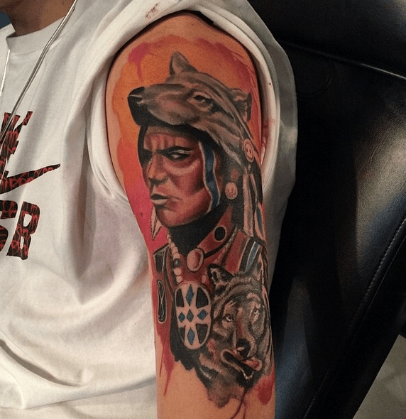 Red wolf headdress on a chief by @infinityprotattooink