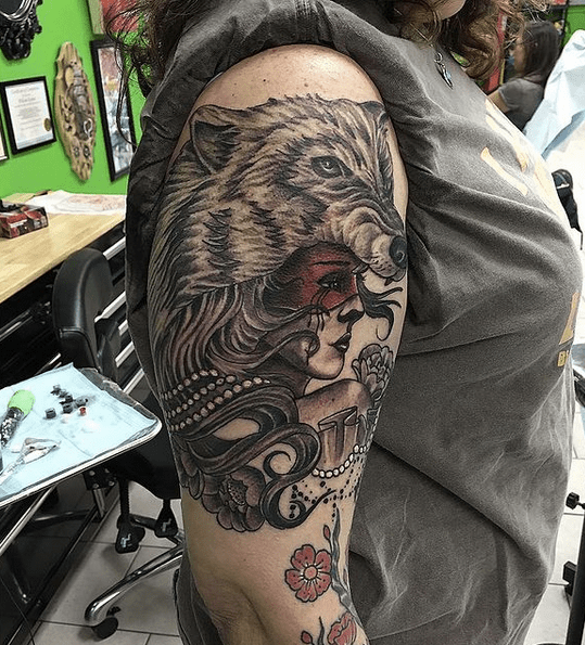 Shoulder wolf headdress tattoo by @willkamas
