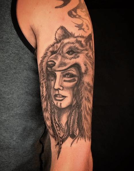 Shoulder wolf headdress tattoo by @winslowtattoo