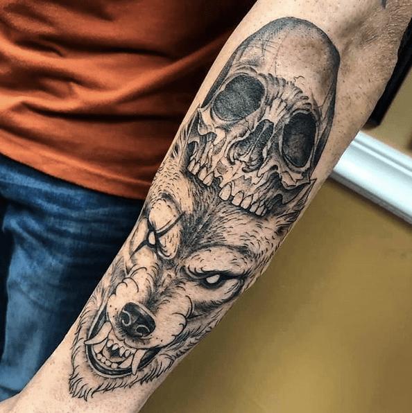 Skull and wolf head tattoo by @artistalecia