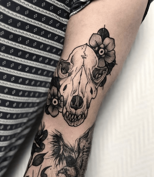 Small flower wolf skull tattoo by @pina_ink