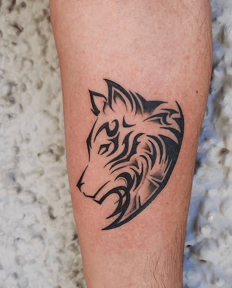 Small tribal wolf head tattoo by @_artist_for_life