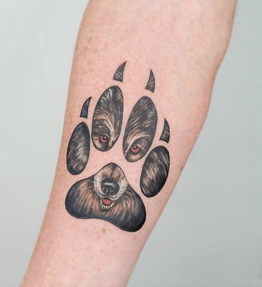Small wolf paw tattoo by @hannah.evolution