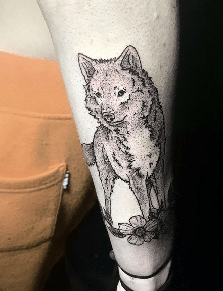 Small wolf tattoo with a flower by @cypresstattoos
