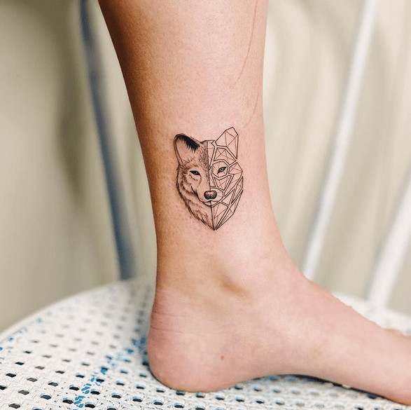 Tiny ankle wolf tattoo by @hailey_blossom