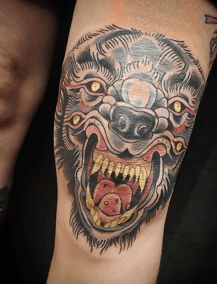 Traditional aggressive wolf head tattoo by @joelletattoo