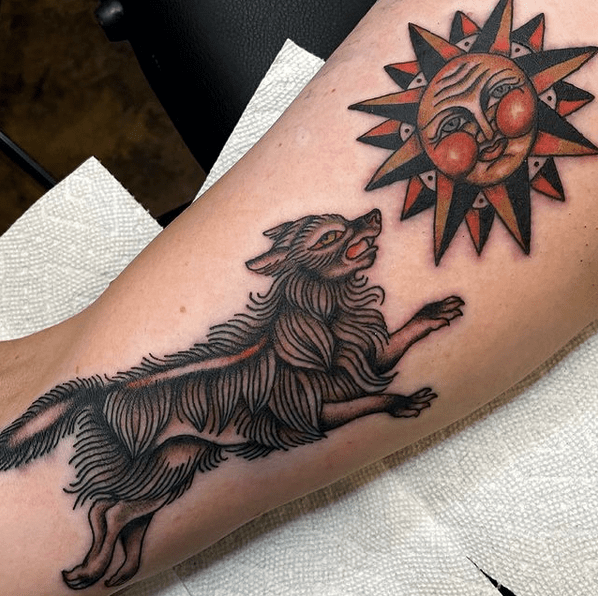 Traditional wolf and sun tattoo by @chelseakotzurtattoo2