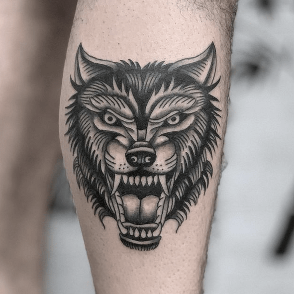 Traditional wolf head tattoo by @micahnorman