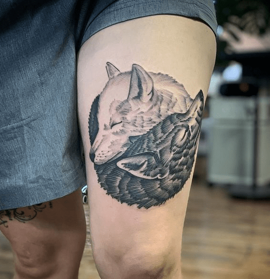 Two cuddling wolves tattoo by @ani.mal.tattoo