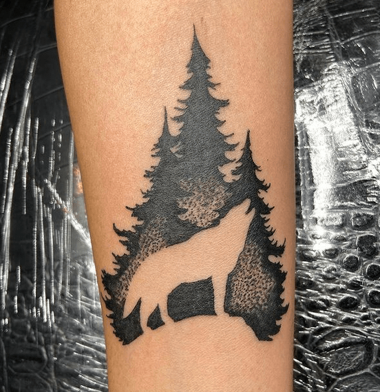 Wolf in trees tattoo by @sinningink