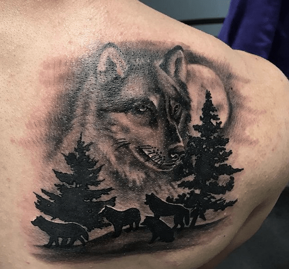 Wolf overlooking the pack tattoo by @hollehellfire.tattoo