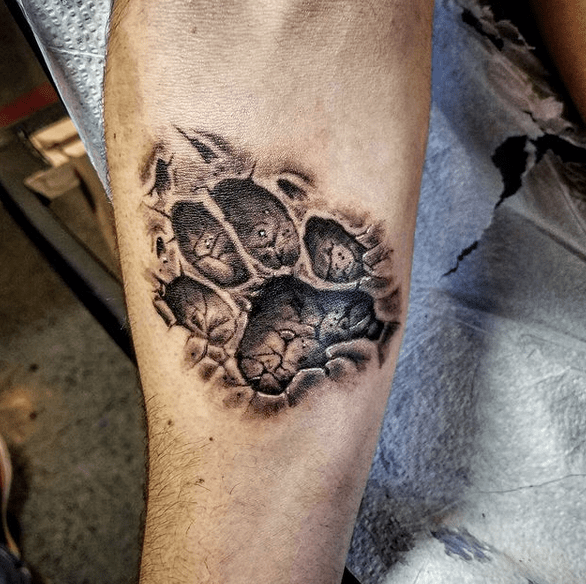 Wolf paw print in dirt by @eriklunatattoos