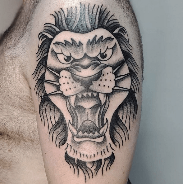 Aggressive traditional lion tattoo by @dionedapper