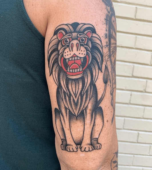 Black and red traditional lion tattoo by @redgrizzly123
