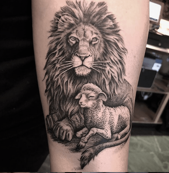 Black and white lion and lamb tattoo by @martinkellytattoo