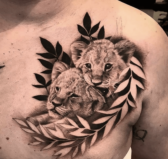 Black and white lion cubs tattoo by @inkformed