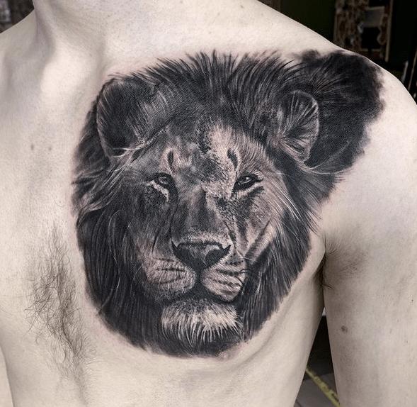 Black lion head tattoo by @beckyfostertattoo