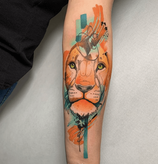 Blue and orange watercolor lion tattoo by @kamil_art_tattoo