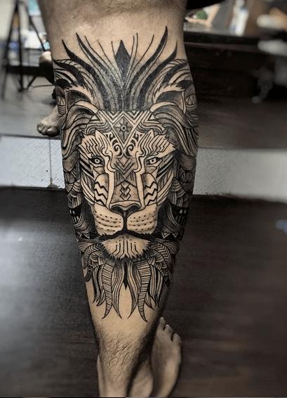 Calf tribal lion tattoo by @ajayvalmiki108