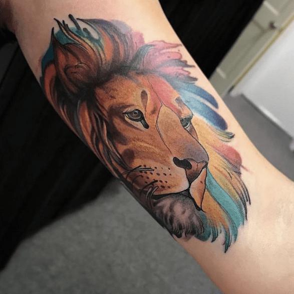 Colorful watercolor lion head tattoo by @bridgettrenea