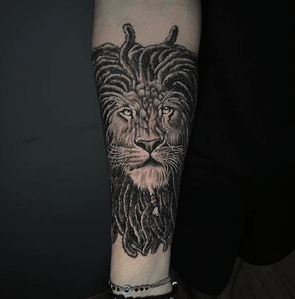 Dreadlock rastafari lion tattoo by @eduardoinsidetattoo